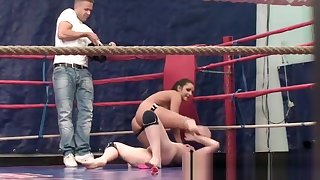 Athletic lesbians wrestling in a boxing ring
