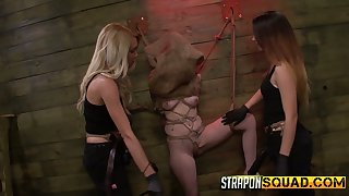 Two mistresses wearing strapons fuck tied up and restrained bitch Sheena Rose