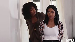 Jenna Foxx and Misty Stone are making adulate all over each other and using a double ended dildo