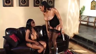 Dark-skinned couple milf play on the sofa up giant communistic dildo, lick eachother and squirt on face